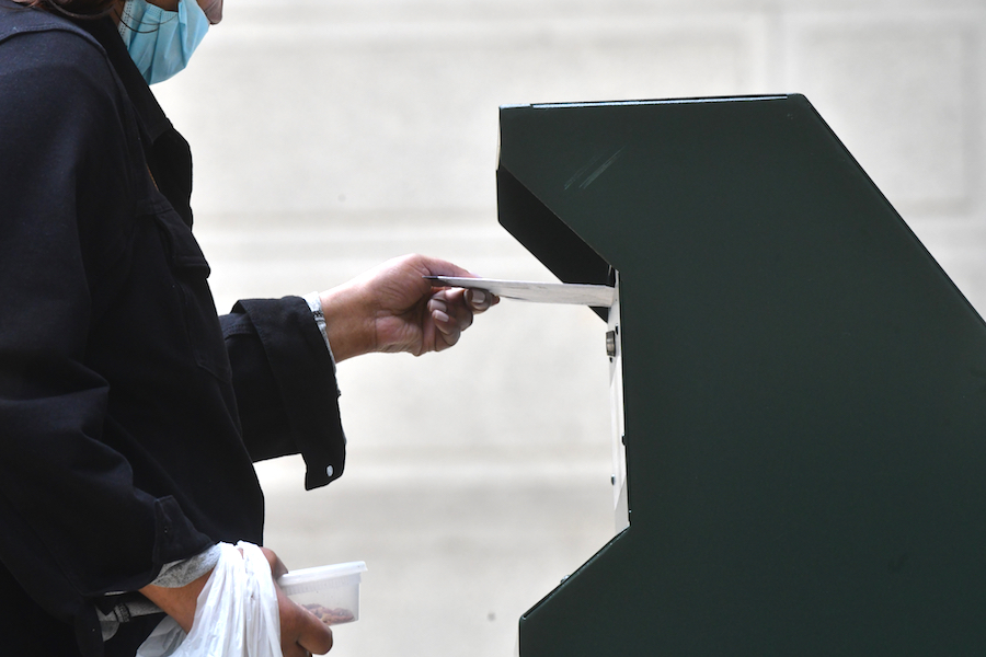 a woman places her pennsylvania mail-in ballot into a dropbox at City Hall, and now some voters are worried because their pennsylvania mail in ballot status still shows up as pending