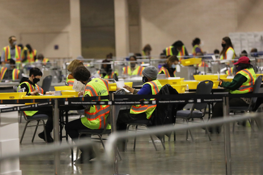 workers count the Philadelphia vote inside the Pennsylvania Convention Center, which will play a big part in the Pennsylvania election results