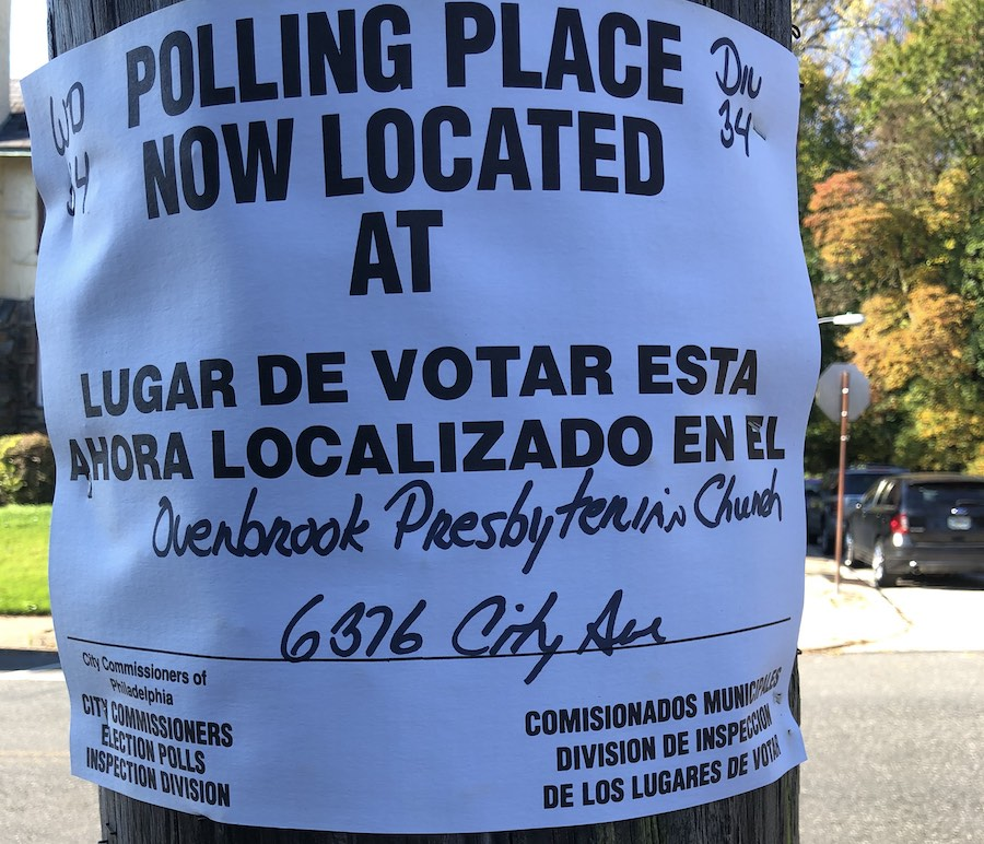 a sign indicating a polling place change on Election Day in Philadelphia