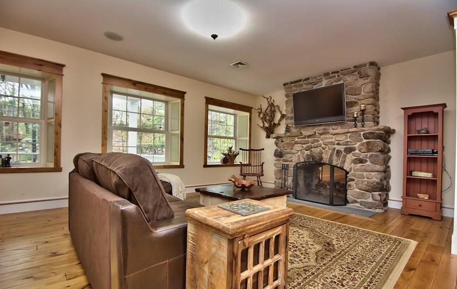 house for sale buck hill falls stone cottage living room