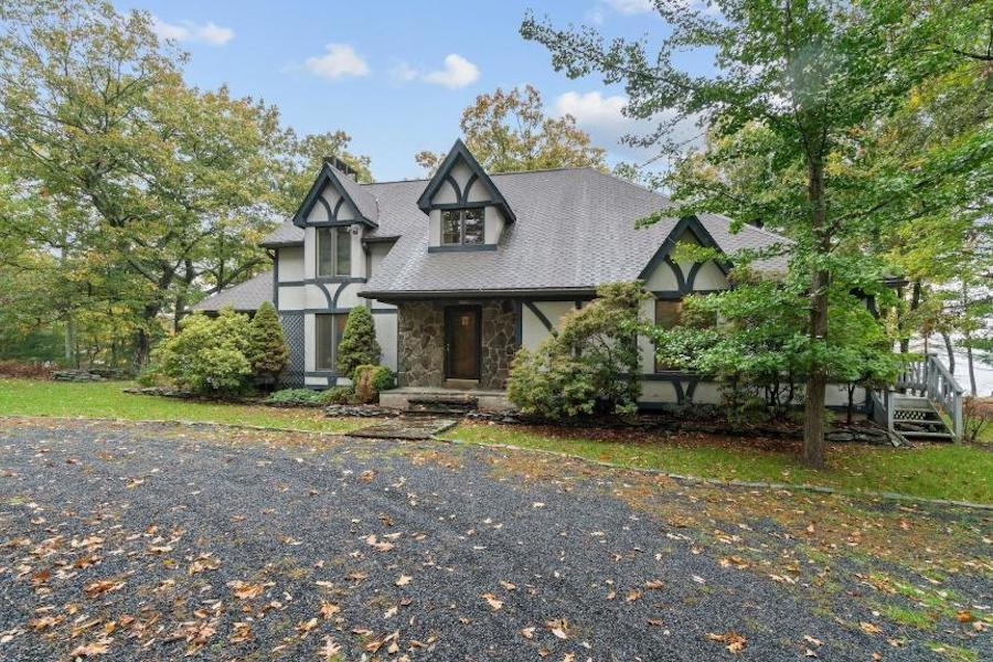 house for sale Milford lakefront Tudor exterior front