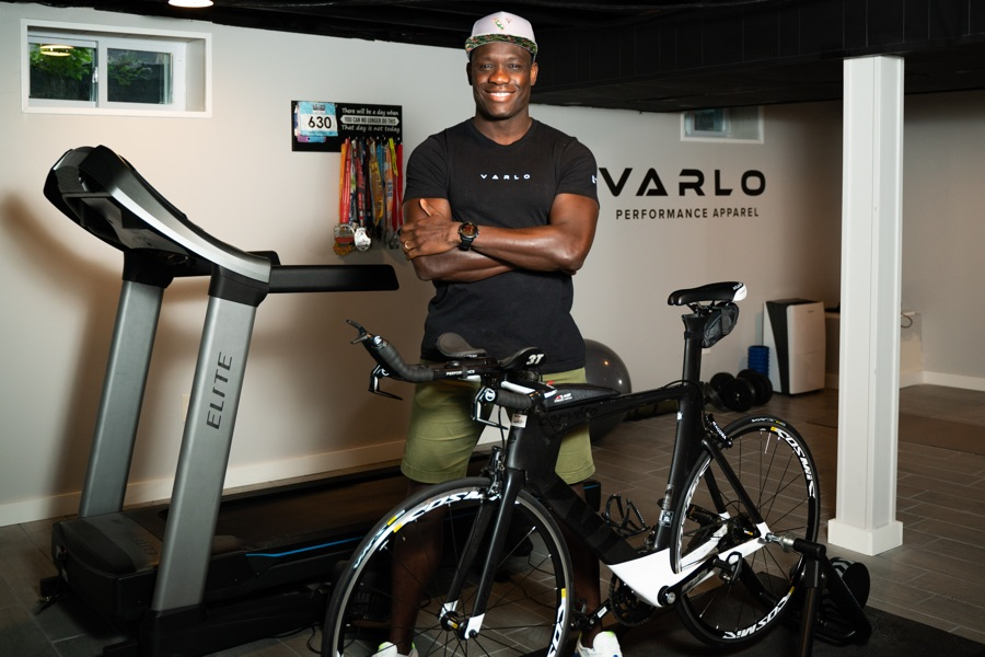 Varlo owner Soj Jibowu stands with a bike and treadmill.