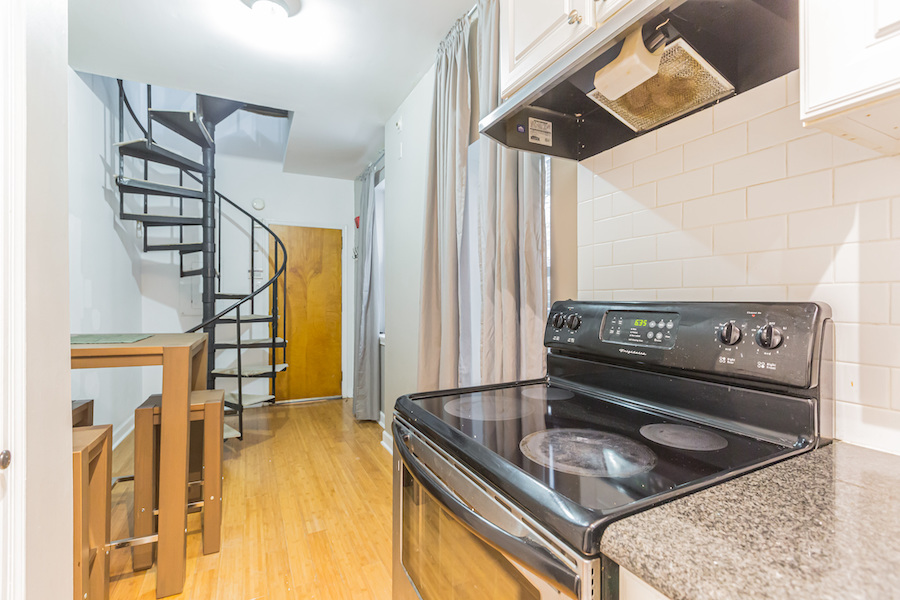condo for sale society hill secret trinity front door and staircase from kitchen