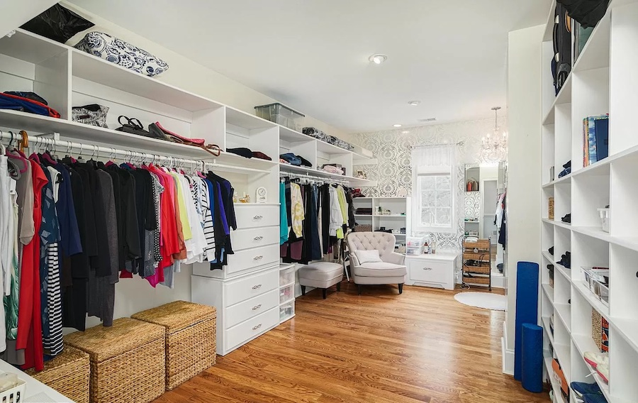 primary bedroom closet and dressing room