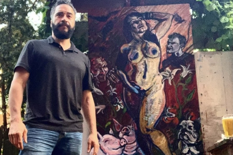raphael tiberino and his painting, which was stolen from his west philadelphia home on Sunday