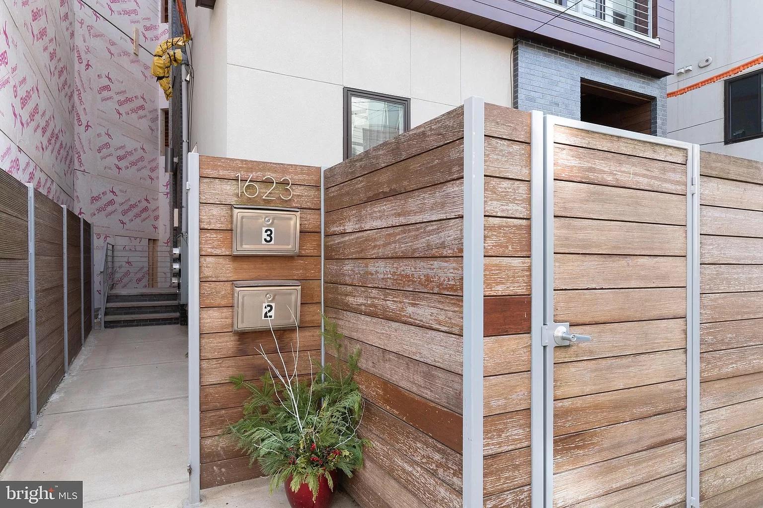 condo for sale francisville split-level Ogden Street entrance