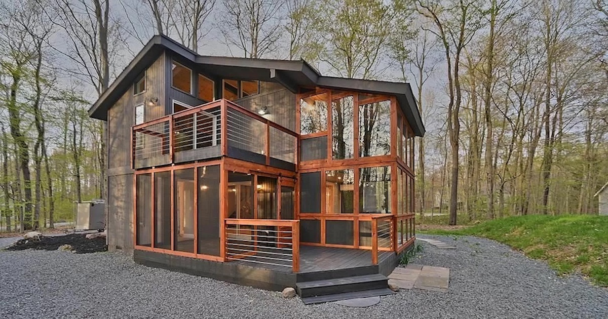 house for sale lake naomi rebuilt contemporary exterior front pmar fb.