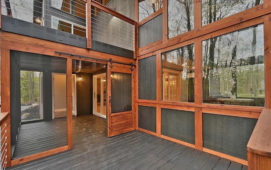 house for sale Lake Naomi rebuilt contemporary main entrance and sunroom