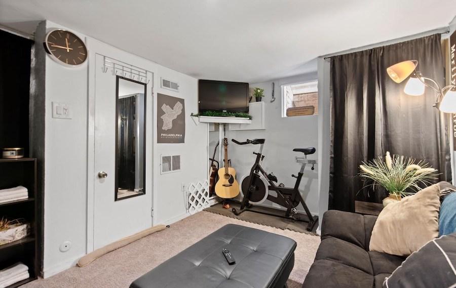house for sale queen village loft trinity basement living room
