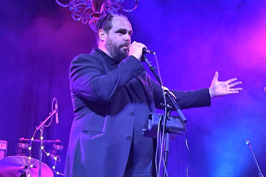 Paul Green of the Paul Green Rock Academy addressing the crowd ahead of the start of Jon Anderson's tour in Woodstock