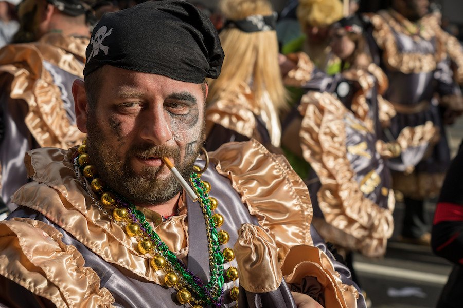 a man smokes a cigarette at the 2019 mummers parade