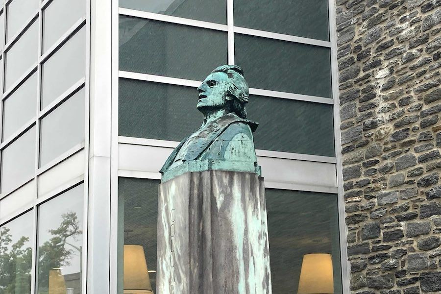 the christopher columbus sculpture outside ludington library in bryn mawr