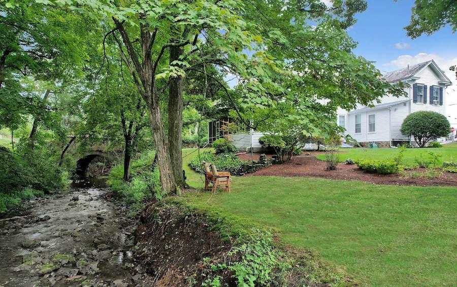 house for sale milford colonial backyard, side yard and vandermark creek