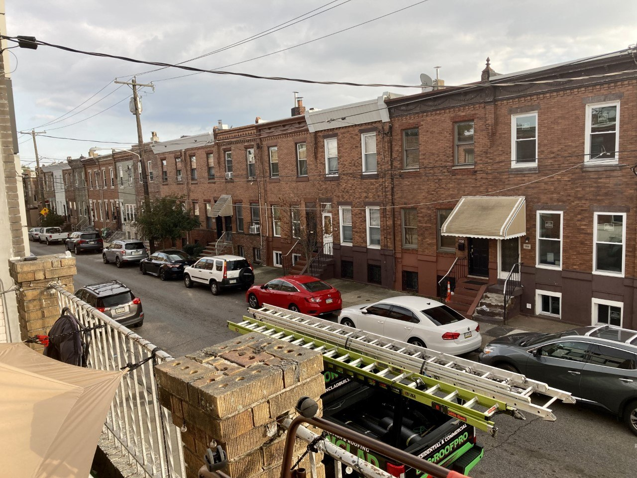a view of the street below from the Airbnb tent on a roof in South Philly